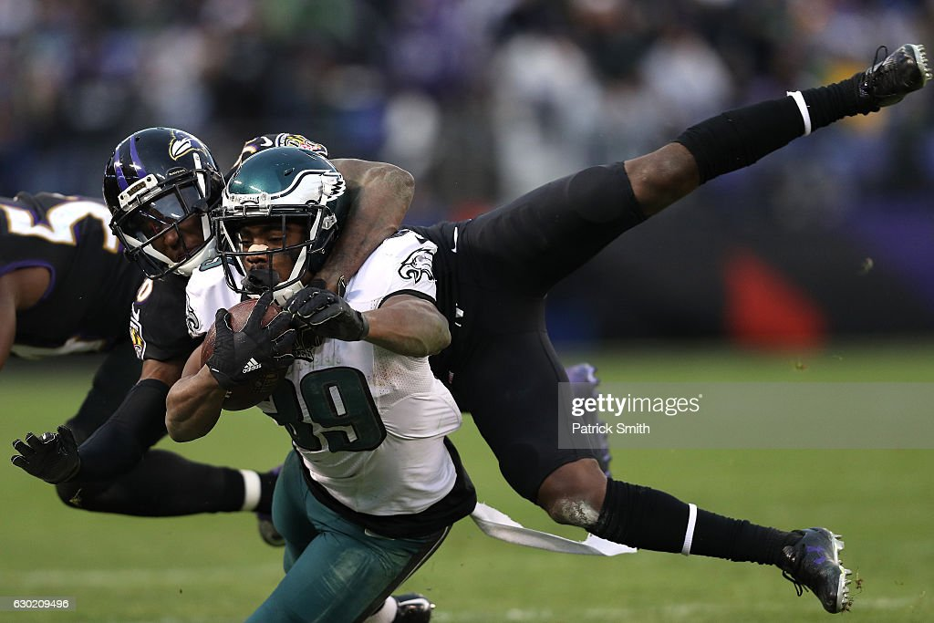 Wide receiver Byron Marshall #39 of the Philadelphia Eagles is tackled by cornerback Tavon Young #36 of the Baltimore Ravens in the fourth quarter at M&T Bank Stadium on December 18, 2016 in Baltimore, Maryland.