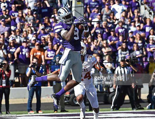 Wide receiver Byron Pringle of the Kansas State Wildcats catches a touchdown pass against defensive back John Bonney of the Texas Longhorns during...