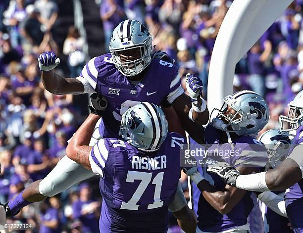 Wide receiver Byron Pringle of the Kansas State Wildcats celebrates after catching a touchdown pass against the Texas Longhorns during the first half...