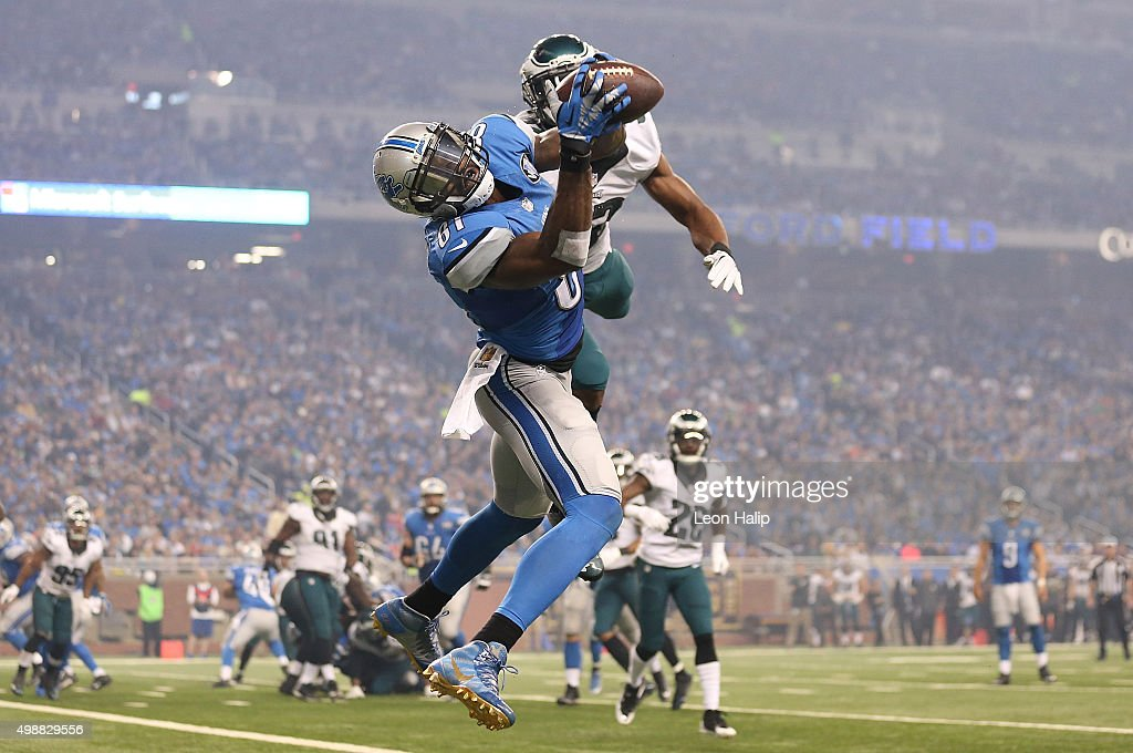 Wide receiver <a gi-track='captionPersonalityLinkClicked' href=/galleries/search?phrase=Calvin+Johnson+-+American+Football+Player&family=editorial&specificpeople=2253942 ng-click='$event.stopPropagation()'>Calvin Johnson</a> #81 of the Detroit Lions catches a third quarter touchdown in front of cornerback <a gi-track='captionPersonalityLinkClicked' href=/galleries/search?phrase=Eric+Rowe&family=editorial&specificpeople=9854851 ng-click='$event.stopPropagation()'>Eric Rowe</a> #32 of the Philadelphia Eagles on November 26, 2015 at Ford Field in Detroit, Michigan.