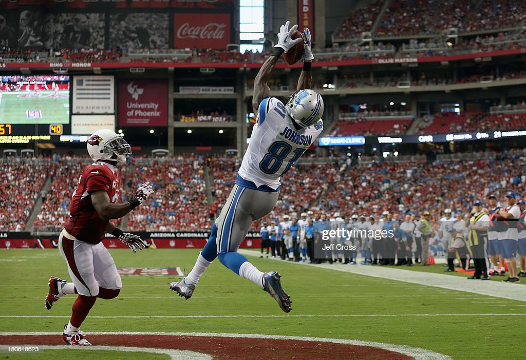 Wide receiver <a gi-track='captionPersonalityLinkClicked' href=/galleries/search?phrase=Calvin+Johnson+-+American+Football+Player&family=editorial&specificpeople=2253942 ng-click='$event.stopPropagation()'>Calvin Johnson</a> #81 of the Detroit Lions catches a touchdown pass in front of cornerback <a gi-track='captionPersonalityLinkClicked' href=/galleries/search?phrase=Patrick+Peterson&family=editorial&specificpeople=5582456 ng-click='$event.stopPropagation()'>Patrick Peterson</a> #21 of the Arizona Cardinals in the first half at University of Phoenix Stadium on September 15, 2013 in Glendale, Arizona.