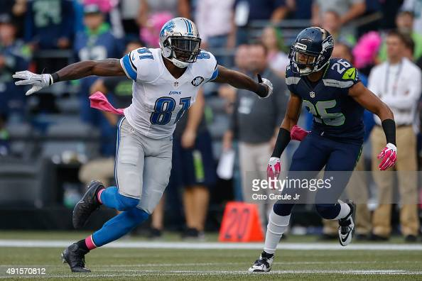Calvin johnson of the detroit lions in action against cornerback