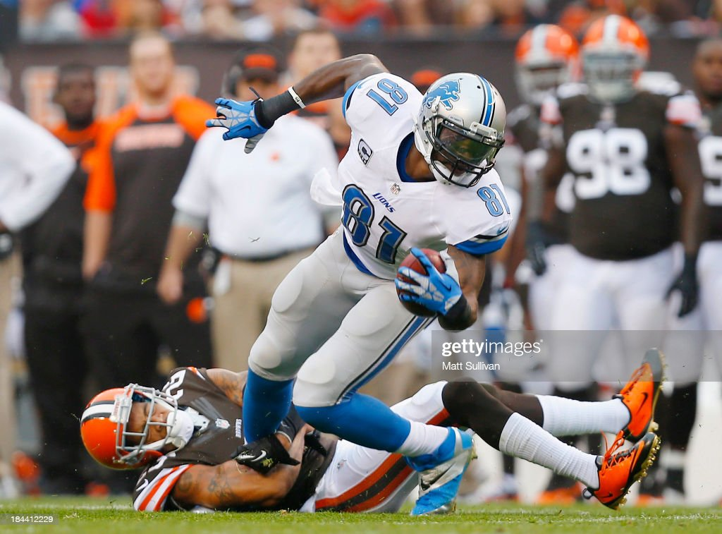 Wide receiver <a gi-track='captionPersonalityLinkClicked' href=/galleries/search?phrase=Calvin+Johnson+-+American+Football+Player&family=editorial&specificpeople=2253942 ng-click='$event.stopPropagation()'>Calvin Johnson</a> #81 of the Detroit Lions is hit by defensive back <a gi-track='captionPersonalityLinkClicked' href=/galleries/search?phrase=Joe+Haden&family=editorial&specificpeople=4489430 ng-click='$event.stopPropagation()'>Joe Haden</a> #23 of the Cleveland Browns at FirstEnergy Stadium on October 13, 2013 in Cleveland, Ohio.