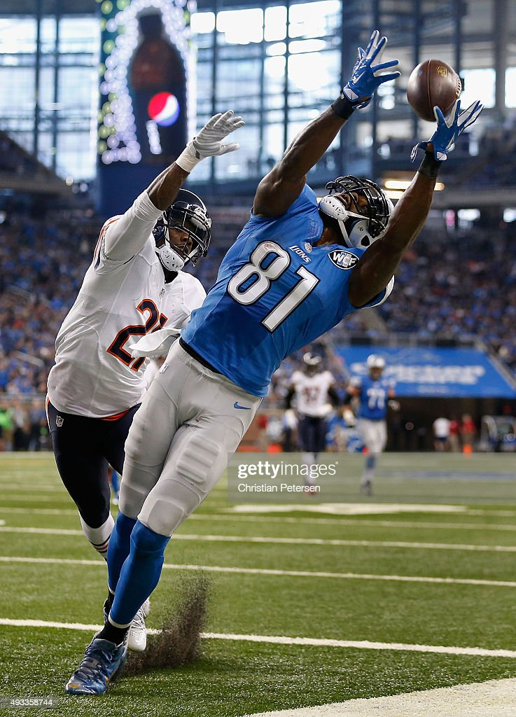 Wide receiver <a gi-track='captionPersonalityLinkClicked' href=/galleries/search?phrase=Calvin+Johnson+-+American+Football+Player&family=editorial&specificpeople=2253942 ng-click='$event.stopPropagation()'>Calvin Johnson</a> #81 of the Detroit Lions is unable to catch a pass guarded by strong safety <a gi-track='captionPersonalityLinkClicked' href=/galleries/search?phrase=Ryan+Mundy&family=editorial&specificpeople=2562453 ng-click='$event.stopPropagation()'>Ryan Mundy</a> #21 of the Chicago Bears during the first quarter of the NFL game at Ford Field on October 18, 2015 in Detroit, Michigan. The Lions defeated the Bears 37-34 in overtime.