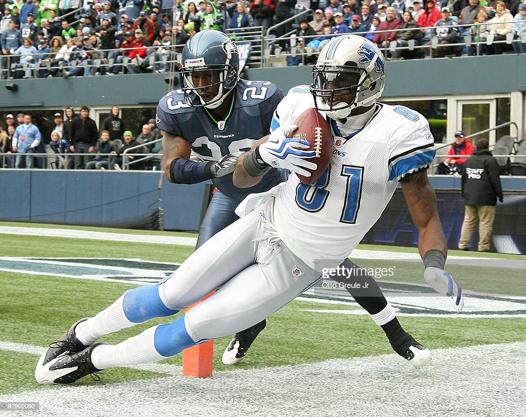 Wide receiver <a gi-track='captionPersonalityLinkClicked' href=/galleries/search?phrase=Calvin+Johnson+-+American+Football+Player&family=editorial&specificpeople=2253942 ng-click='$event.stopPropagation()'>Calvin Johnson</a> #81 of the Detroit Lions makes a catch at the one-yard line against <a gi-track='captionPersonalityLinkClicked' href=/galleries/search?phrase=Marcus+Trufant&family=editorial&specificpeople=209131 ng-click='$event.stopPropagation()'>Marcus Trufant</a> #23 of the Seattle Seahawks on November 8, 2009 at Qwest Field in Seattle, Washington. Johnson was ruled out of bounds on the play and the Seahawks defeated the Lions 32-20.