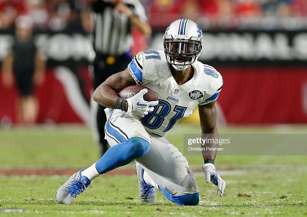 Wide receiver <a gi-track='captionPersonalityLinkClicked' href=/galleries/search?phrase=Calvin+Johnson+-+American+Football+Player&family=editorial&specificpeople=2253942 ng-click='$event.stopPropagation()'>Calvin Johnson</a> #81 of the Detroit Lions reacts after a reception during the NFL game against the Arizona Cardinals at the University of Phoenix Stadium on November 16, 2014 in Glendale, Arizona.