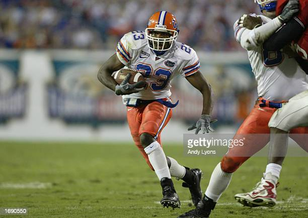 Wide Receiver Carlos Perez of the Florida Gators runs for yards during the game against the Georgia Bulldogs at Alltel Stadium on November 2 2002 in...