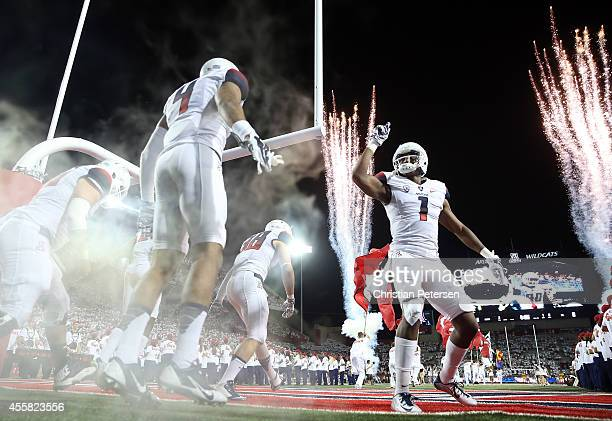 Wide receiver Cayleb Jones of the Arizona Wildcats leads teammates out onto the field before the college football game against the California Golden...