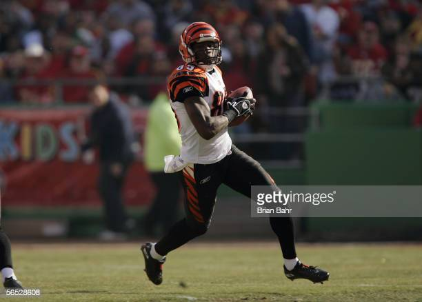 Wide receiver Chad Johnson of the Cincinnati Bengals carries the ball against the Kansas City Chiefs at Arrowhead Stadium on January 1 2006 in Kansas...