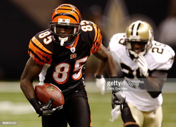 Wide receiver Chad Ochocinco of the Cincinnati Bengals runs with the ball against the New Orleans Saints during a preseason game on August 14 2009 at...