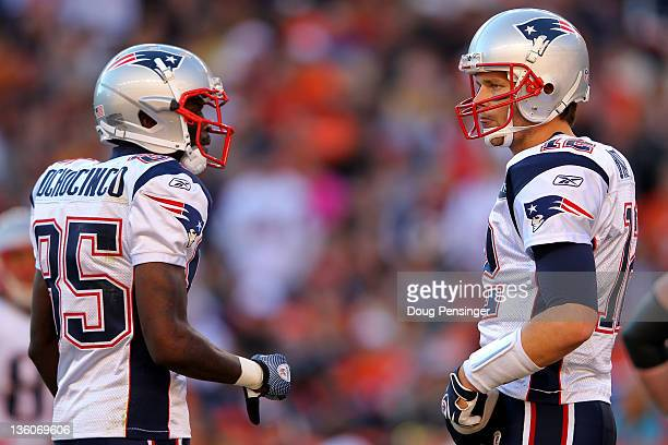 Wide receiver Chad Ochocinco talks with quarterback Tom Brady of the New England Patriots during a game against the Denver Broncos at Sports...