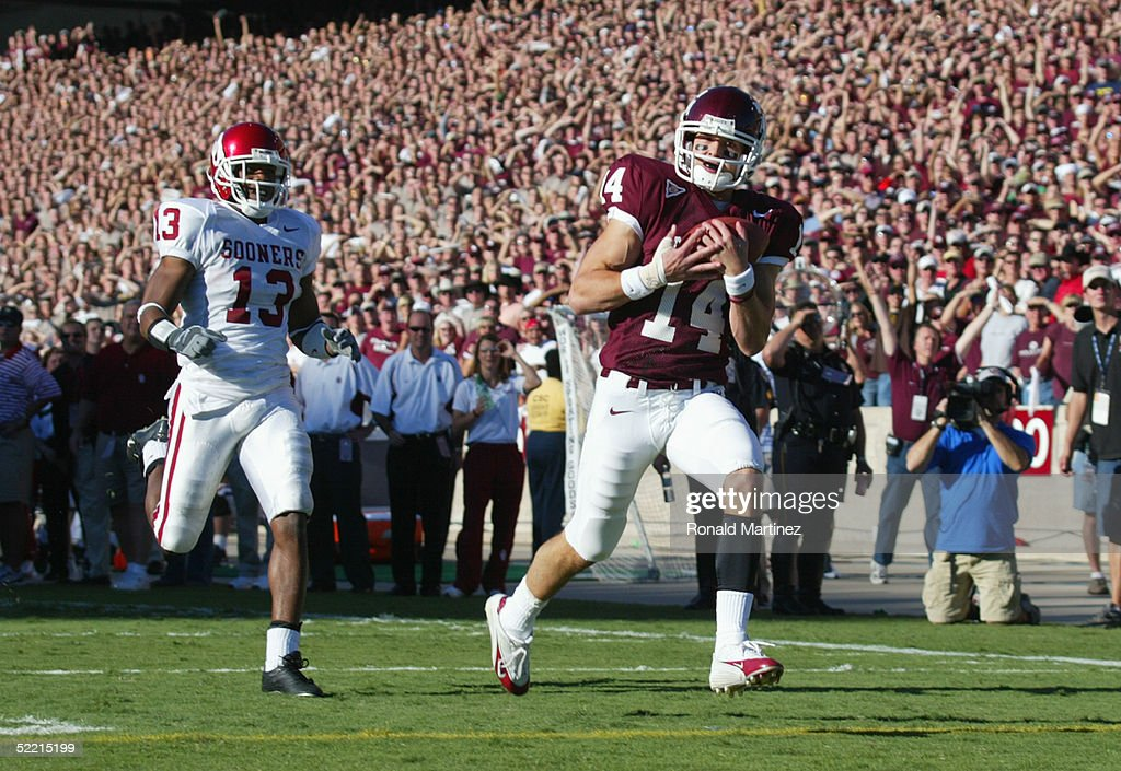 Wide receiver Chad Schroeder #14 of the Texas A&M University Aggies scores a touchdown near defensive back Eric Bassey #13 of the University of Oklahoma Sooners on November 6, 2004 at Kyle Field in College Station, Texas. The Sooners defeated the Aggies 42-35.