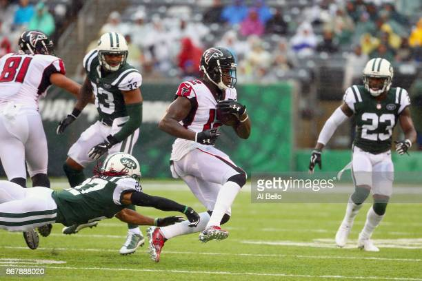 Wide receiver Charone Peake of the New York Jets attempts to tackle wide receiver Mohamed Sanu of the Atlanta Falcons during the first half of the...