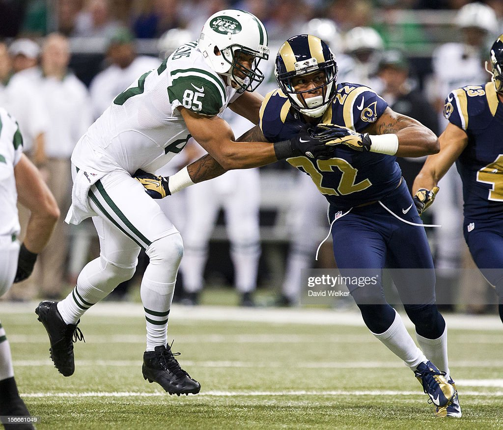 Wide receiver Chaz Schilens #85 of the New York Jets blocks cornerback <a gi-track='captionPersonalityLinkClicked' href=/galleries/search?phrase=Trumaine+Johnson&family=editorial&specificpeople=3915425 ng-click='$event.stopPropagation()'>Trumaine Johnson</a> #22 of the St. Louis Rams on a kickoff return during the game at the Edward Jones Dome on November 18, 2012 in St. Louis, Missouri.