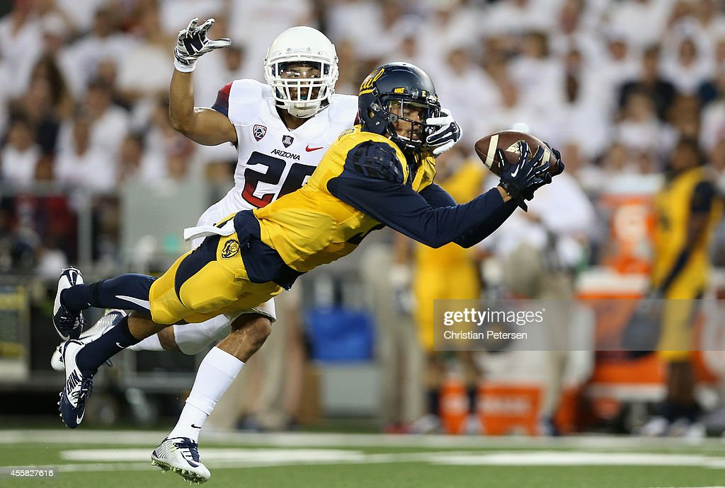 Wide receiver Chris Harper of the California Golden Bears makes a diving 41 yard reception past safety Jourdon Grandon of the Arizona Wildcats during...