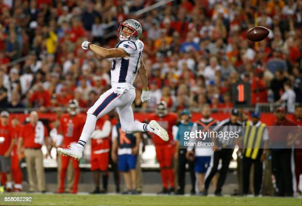 Wide receiver Chris Hogan of the New England Patriots makes an attempt to haul in a pass by quarterback Tom Brady that was intercepted by safety...