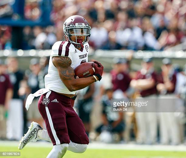 Wide receiver Christian Kirk of the Texas AM Aggies catches a pass for a touchdown during the second half of an NCAA college football game against...