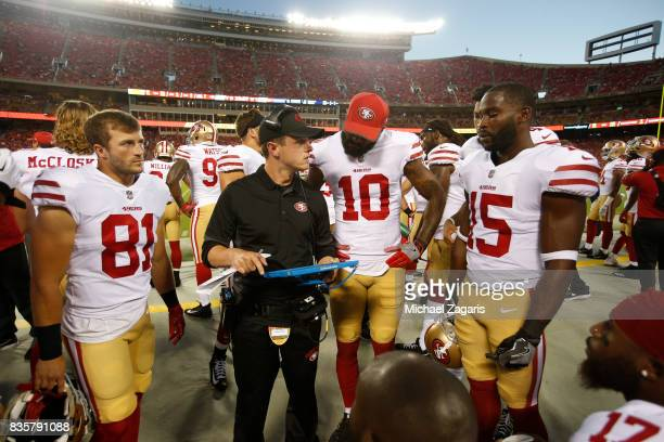 Wide Receiver Coach Mike LaFleur of the San Francisco 49ers talks with Trent Taylor Louis Murphy and Pierre Garcon on the sideline during the game...