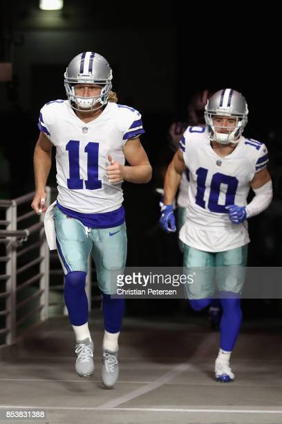 Wide receiver Cole Beasley of the Dallas Cowboys and wide receiver Ryan Switzer run on to the field before the start of the NFL game against the...