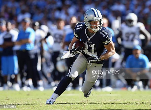 Wide receiver Cole Beasley of the Dallas Cowboys carries the ball against the San Diego Chargers at Qualcomm Stadium on September 29 2013 in San...