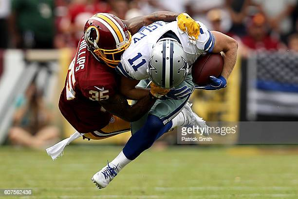 Wide receiver Cole Beasley of the Dallas Cowboys is tackled by defensive back Dashaun Phillips of the Washington Redskins in the fourth quarter at...