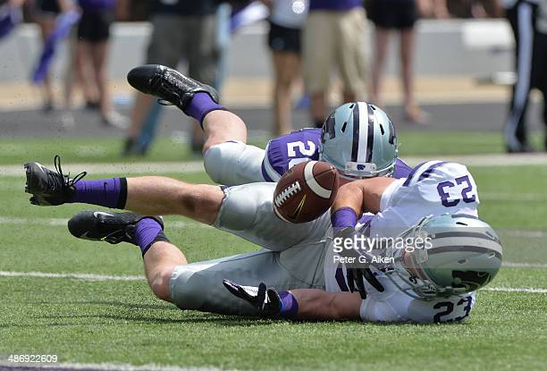 Wide receiver Collin Sexton of the Kansas State Wildcats bobbles a pass attempt during the Spring Game on April 26 2014 at Bill Snyder Family Stadium...