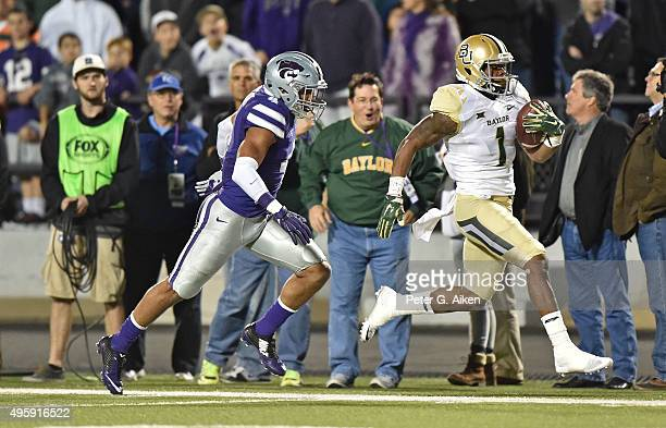 Wide receiver Corey Coleman of the Baylor Bears catches a touchdown pass against freee safety Kaleb Prewett of the Kansas State Wildcats during the...