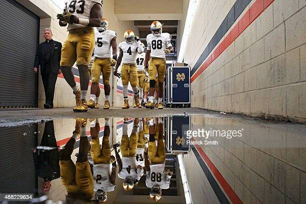 Wide receiver Corey Robinson of the Notre Dame Fighting Irish and teammates walk to the field before playing the Virginia Cavaliers at Scott Stadium...