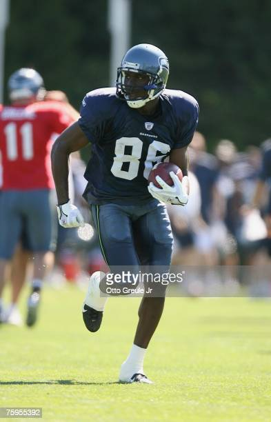 Wide receiver Courtney Taylor of the Seattle Seahawks runs downfield during training camp on July 31 2007 at Seahawks Headquarters in Kirkland...