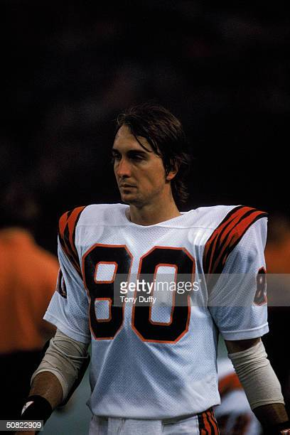 Wide receiver Cris Collinsworth of the Cincinnati Bengals walks on the field during a game in the 1985 NFL Season against the Houston Oilers at the...