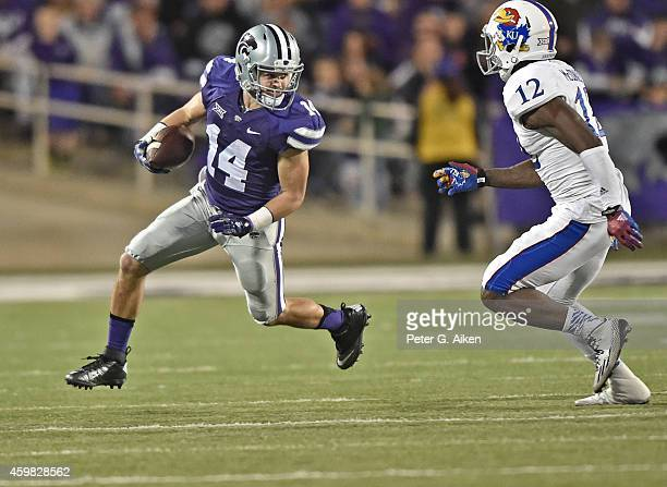 Wide receiver Curry Sexton of the Kansas State Wildcats rushes down field after catching a pass against defensive back Dexter McDonald of the Kansas...