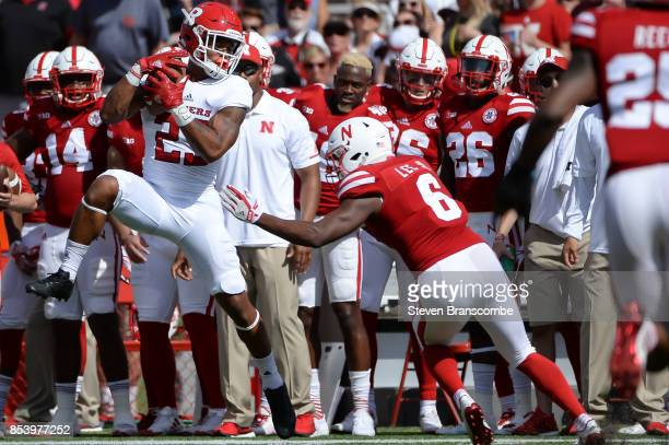 Wide receiver Dacoven Bailey of the Rutgers Scarlet Knights catches a pass in front of defensive back Eric Lee Jr #6 of the Nebraska Cornhuskers at...