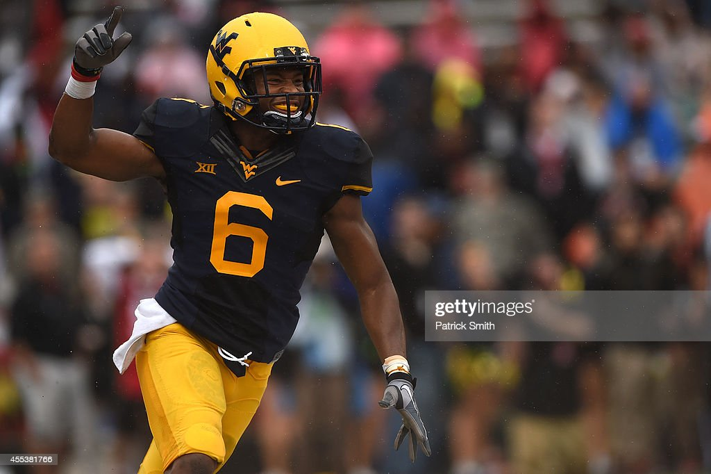 Wide receiver Daikiel Shorts of the West Virginia Mountaineers celebrates a third quarter touchdown against the Maryland Terrapins during an NCAA...