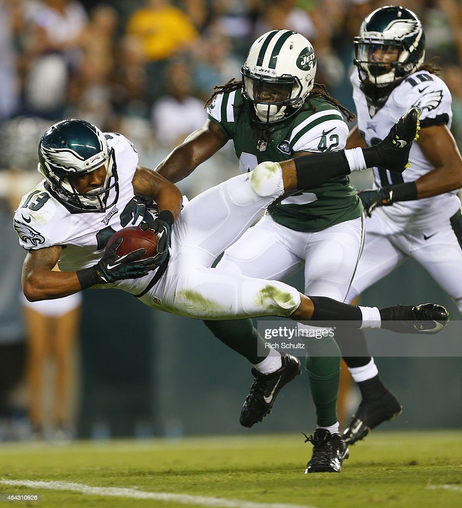 Wide receiver Damaris Johnson #13 of the Philadelphia Eagles scores a touchdown in the preseason game against the New York Jets on August 28, 2014 at Lincoln Financial Field in Philadelphia, Pennsylvania.