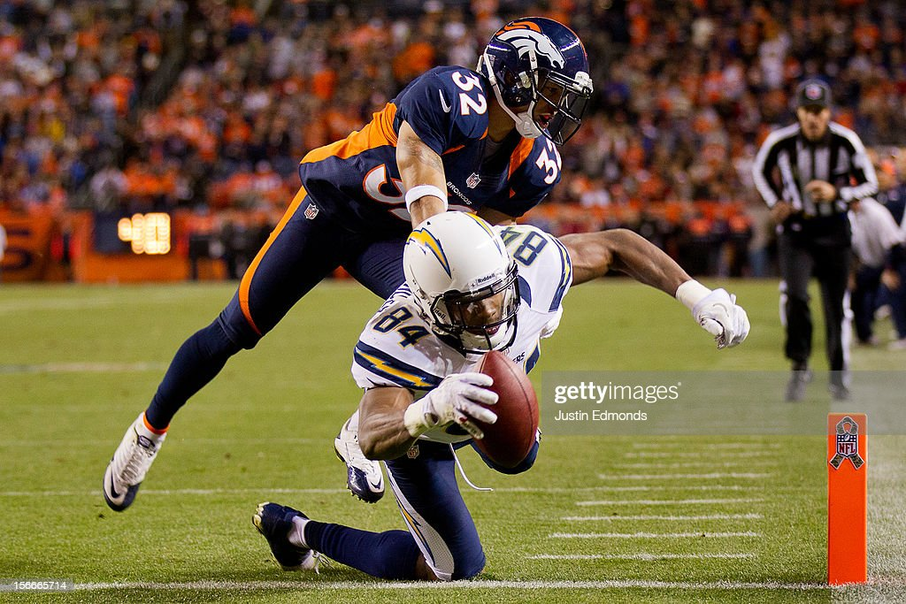 Wide receiver Danario Alexander #84 of the San Diego Chargers reaches across the goal line for a touchdown as cornerback Tony Carter #32 of the Denver Broncos defends during the fourth quarter at Sports Authority Field Field at Mile High on November 18, 2012 in Denver, Colorado. The Broncos defeated the Chargers 30-23.