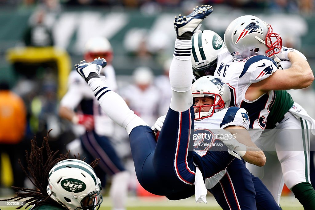 Wide receiver Danny Amendola #80 of the New England Patriots is tackled by free safety Calvin Pryor #25 of the New York Jets in the first quarter during a game at MetLife Stadium on December 21, 2014 in East Rutherford, New Jersey.