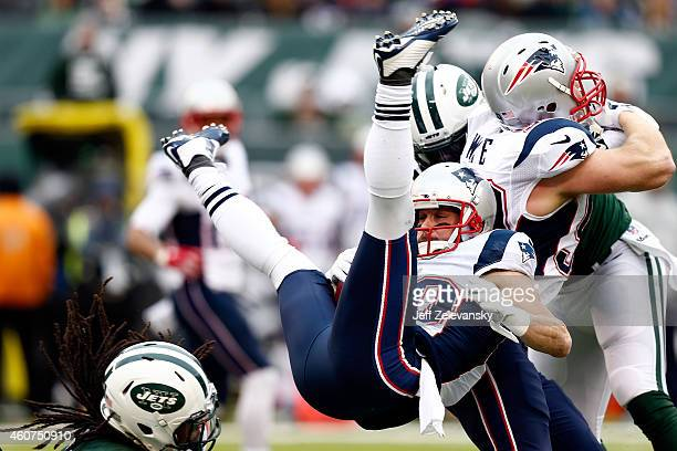 Wide receiver Danny Amendola of the New England Patriots is tackled by free safety Calvin Pryor of the New York Jets in the first quarter during a...