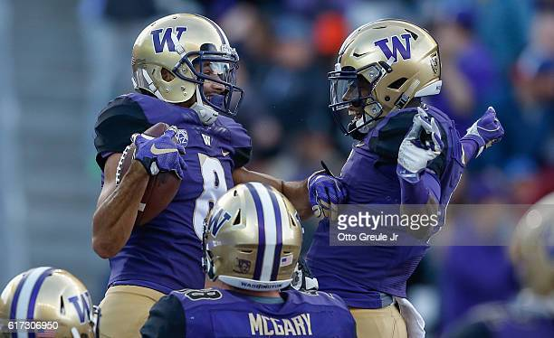 Wide receiver Dante Pettis of the Washington Huskies is congratulated by wide receiver John Ross after scoring a touchdown against the Oregon State...