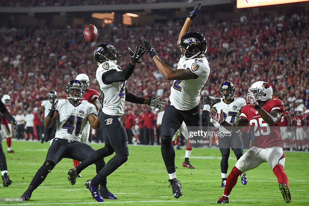 Wide receiver <a gi-track='captionPersonalityLinkClicked' href=/galleries/search?phrase=Darren+Waller&family=editorial&specificpeople=8583964 ng-click='$event.stopPropagation()'>Darren Waller</a> #12 of the Baltimore Ravens flips the ball in midair to cornerback <a gi-track='captionPersonalityLinkClicked' href=/galleries/search?phrase=Anthony+Levine+-+American+Football+Player&family=editorial&specificpeople=7148455 ng-click='$event.stopPropagation()'>Anthony Levine</a> #41 downing the ball at the one-yard line in the second quarter of the NFL game against the Arizona Cardinals at University of Phoenix Stadium on October 26, 2015 in Glendale, Arizona.