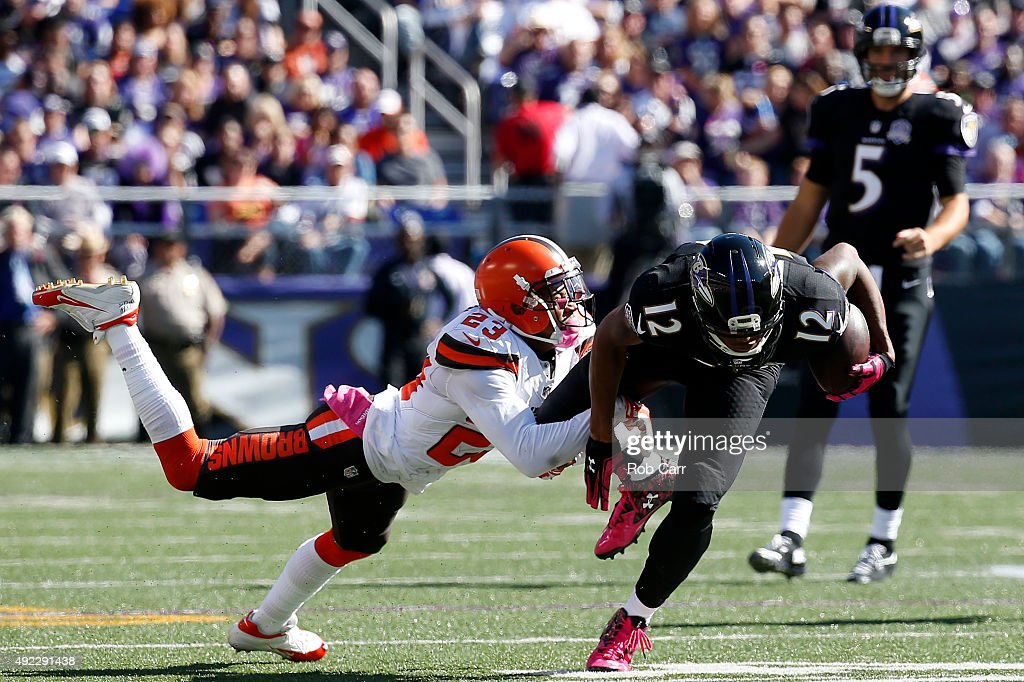 Wide receiver <a gi-track='captionPersonalityLinkClicked' href=/galleries/search?phrase=Darren+Waller&family=editorial&specificpeople=8583964 ng-click='$event.stopPropagation()'>Darren Waller</a> #12 of the Baltimore Ravens is tackled by cornerback <a gi-track='captionPersonalityLinkClicked' href=/galleries/search?phrase=Joe+Haden&family=editorial&specificpeople=4489430 ng-click='$event.stopPropagation()'>Joe Haden</a> #23 of the Cleveland Browns in the second quarter of a game at M&T Bank Stadium on October 11, 2015 in Baltimore, Maryland.