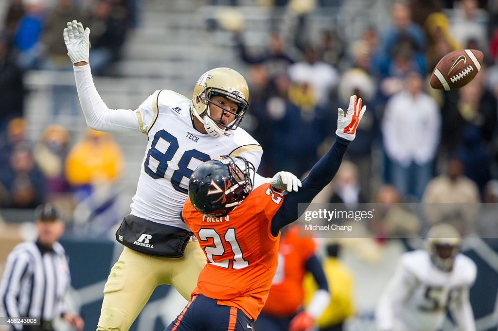 Wide receiver <a gi-track='captionPersonalityLinkClicked' href=/galleries/search?phrase=Darren+Waller&family=editorial&specificpeople=8583964 ng-click='$event.stopPropagation()'>Darren Waller</a> #88 of the Georgia Tech Yellow Jackets attempts to catch a pass over safety Brandon Phelps #21 of the Virginia Cavaliers on November 1, 2014 at Bobby Dodd Stadium in Atlanta, Georgia. The Georgia Tech Yellow Jackets defeated the Virginia Cavaliers 35-10.