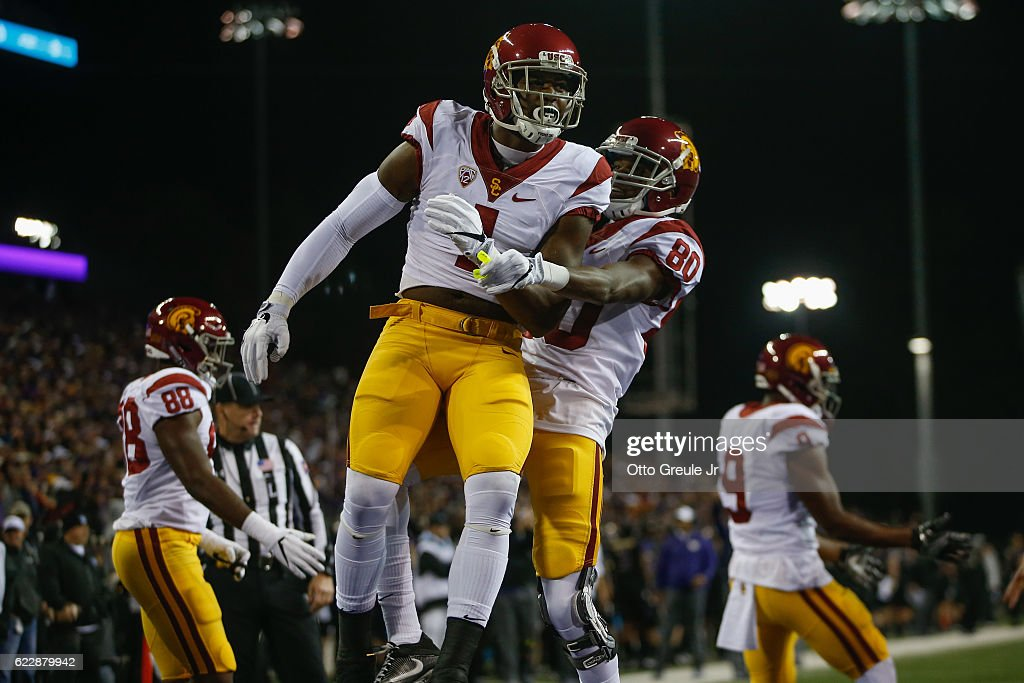 Wide receiver Darreus Rogers #1 of the USC Trojans is congratulated by wide receiver Deontay Burnett #80 after scoring a touchdown against the Washington Huskies in the second quarter on November 12, 2016 at Husky Stadium in Seattle, Washington.