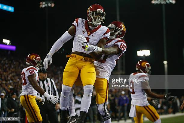 Wide receiver Darreus Rogers of the USC Trojans is congratulated by wide receiver Deontay Burnett after scoring a touchdown against the Washington...