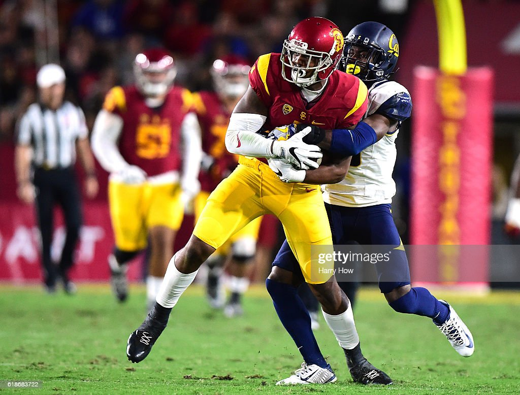 Wide receiver Darreus Rogers #1 of the USC Trojans is wrapped up by cornerback Marloshawn Franklin Jr. #18 of the California Golden Bears after his catch during the second quarter at Los Angeles Coliseum on October 27, 2016 in Los Angeles, California.