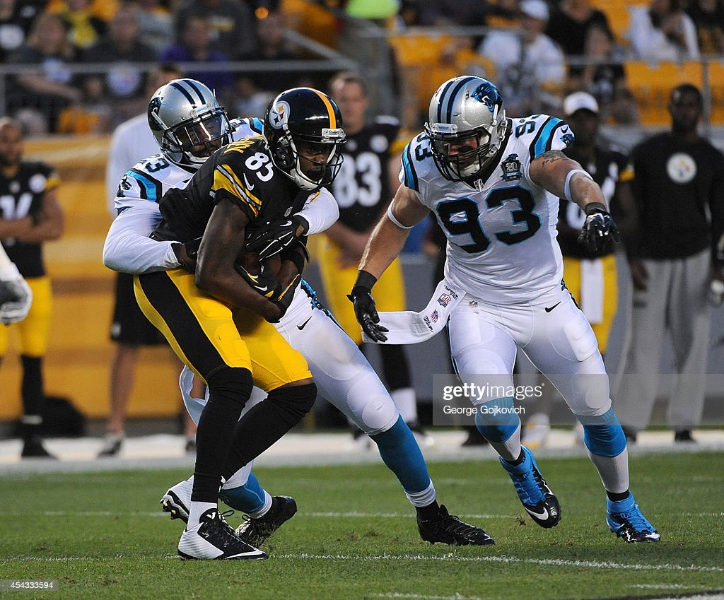 Wide receiver Darrius HeywardBey of the Pittsburgh Steelers is tackled by cornerback Melvin White and linebacker Chase Blackburn of the Carolina...