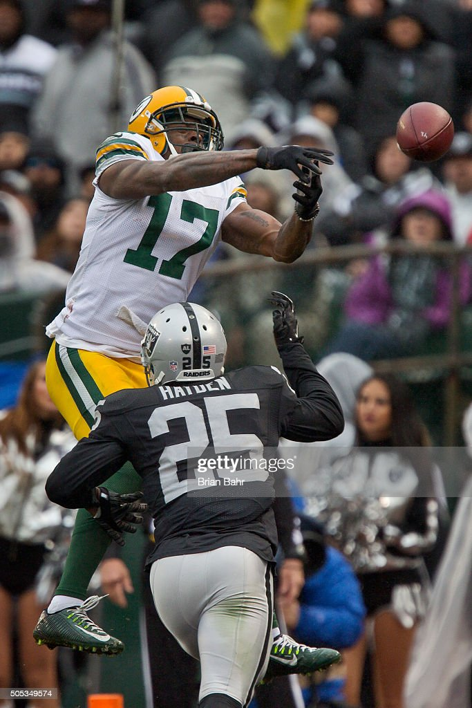 Wide receiver Davante Adams of the Green Bay Packers can't get a handle on the ball against cornerback DJ Hayden of the Oakland Raiders in the third...
