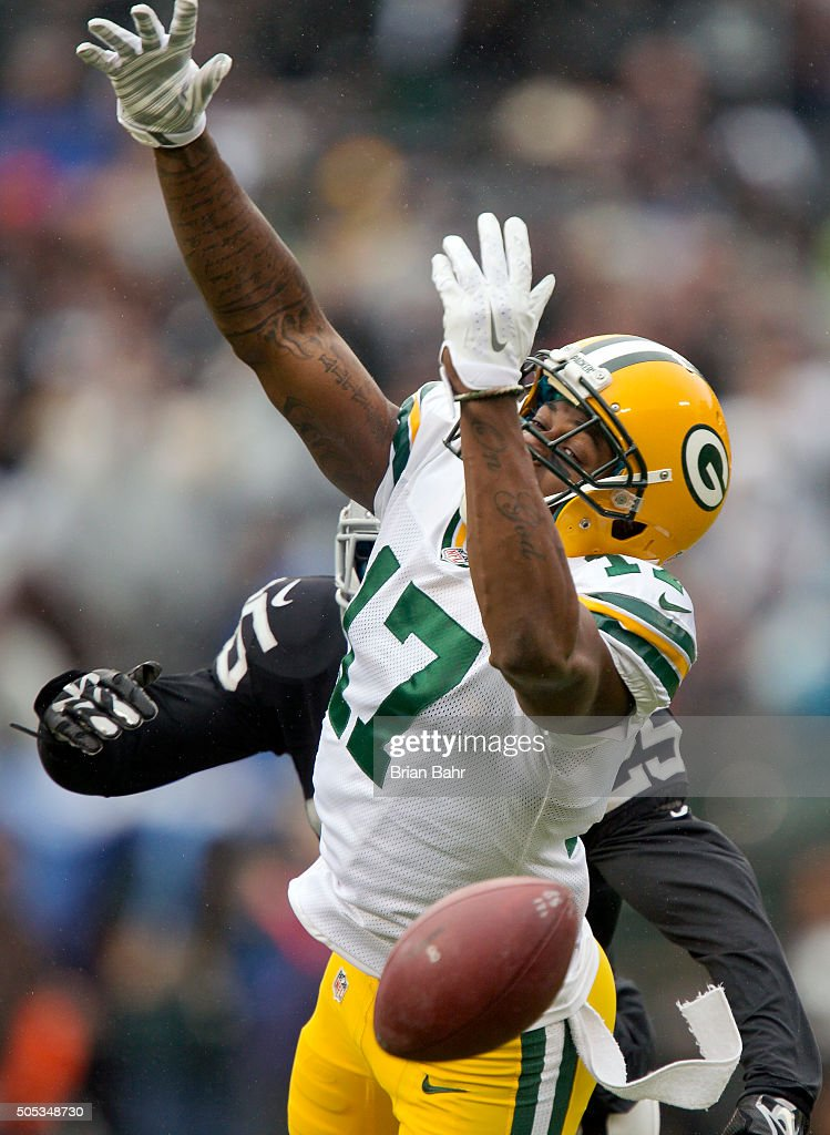 Wide receiver Davante Adams of the Green Bay Packers can't pull in a pass against cornerback DJ Hayden of the Oakland Raiders in the second quarter...