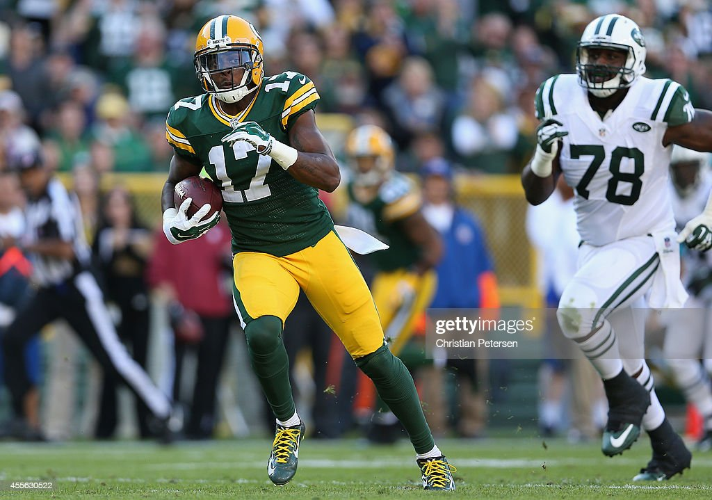 Wide receiver <a gi-track='captionPersonalityLinkClicked' href=/galleries/search?phrase=Davante+Adams&family=editorial&specificpeople=9689136 ng-click='$event.stopPropagation()'>Davante Adams</a> #17 of the Green Bay Packers runs with the football after a reception against the New York Jets during the NFL game at Lambeau Field on September 14, 2014 in Green Bay, Wisconsin. The Packers defeated the Jets 31-24.