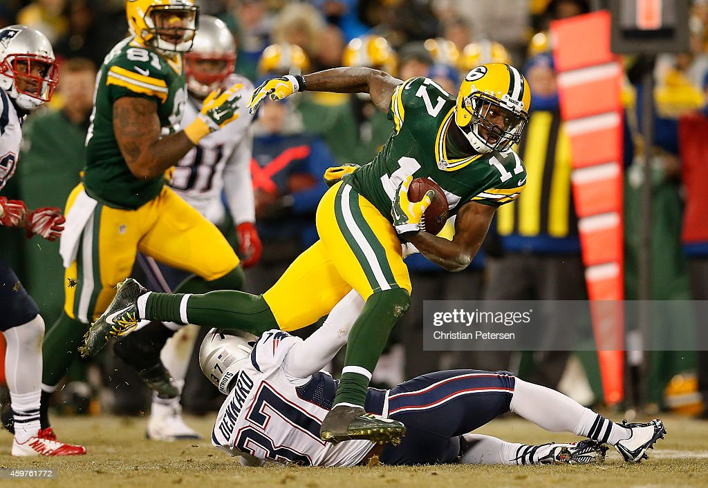 Wide receiver <a gi-track='captionPersonalityLinkClicked' href=/galleries/search?phrase=Davante+Adams&family=editorial&specificpeople=9689136 ng-click='$event.stopPropagation()'>Davante Adams</a> #17 of the Green Bay Packers runs with the football after a reception past cornerback <a gi-track='captionPersonalityLinkClicked' href=/galleries/search?phrase=Alfonzo+Dennard&family=editorial&specificpeople=5651216 ng-click='$event.stopPropagation()'>Alfonzo Dennard</a> #37 of the New England Patriots during the fourth quarter of the NFL game at Lambeau Field on November 30, 2014 in Green Bay, Wisconsin. The Packers defeated the Patriots 26-21.