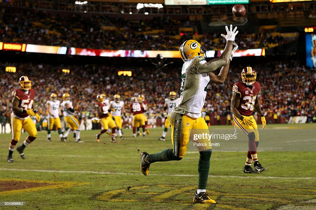 Wide receiver Davante Adams #17 of the Green Bay Packers scores a second-quarter touchdown past free safety Dashon Goldson #38 of the Washington Redskins during the NFC Wild Card Playoff game at FedExField on January 10, 2016 in Landover, Maryland.